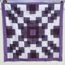 Counterbalance Quilt  made in Purple, Violet and White. Beginner quilt, made with squares.