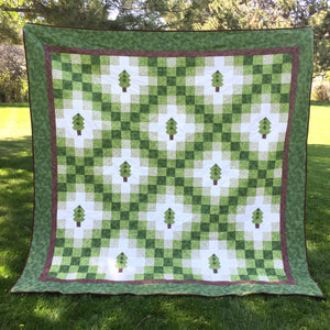 Irish woodland Quilt - queen size - irish chain quilt with a forest of green trees.