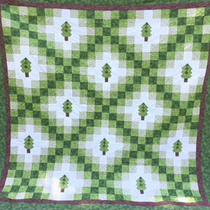 Close up view of Irish woodland quilt for pattern in green and brown