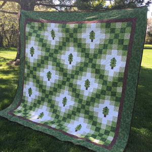 Side view of Irish woodland quilt in green for pattern