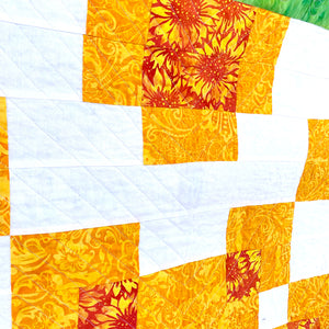 Counterbalance Quilt  made in Orange, Yellow, Green, and White. Beginner quilt, made with squares.