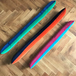 velvet draft excluders in bright pink, turquoise, orange, navy, green and royal blue
