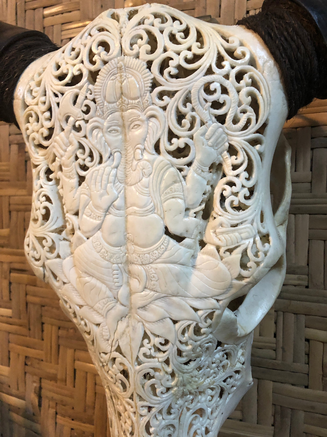 Intricately Carved Cow Skulls with Ganesh