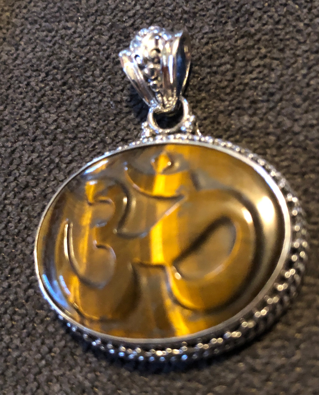 Sterling Silver Handcarved Tigers Eye Om Pendant