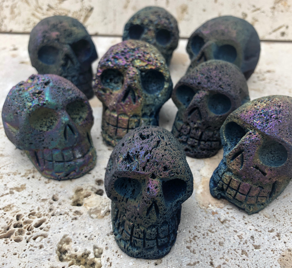 Hand Carved Lava Stone Skulsl with Titanium coating