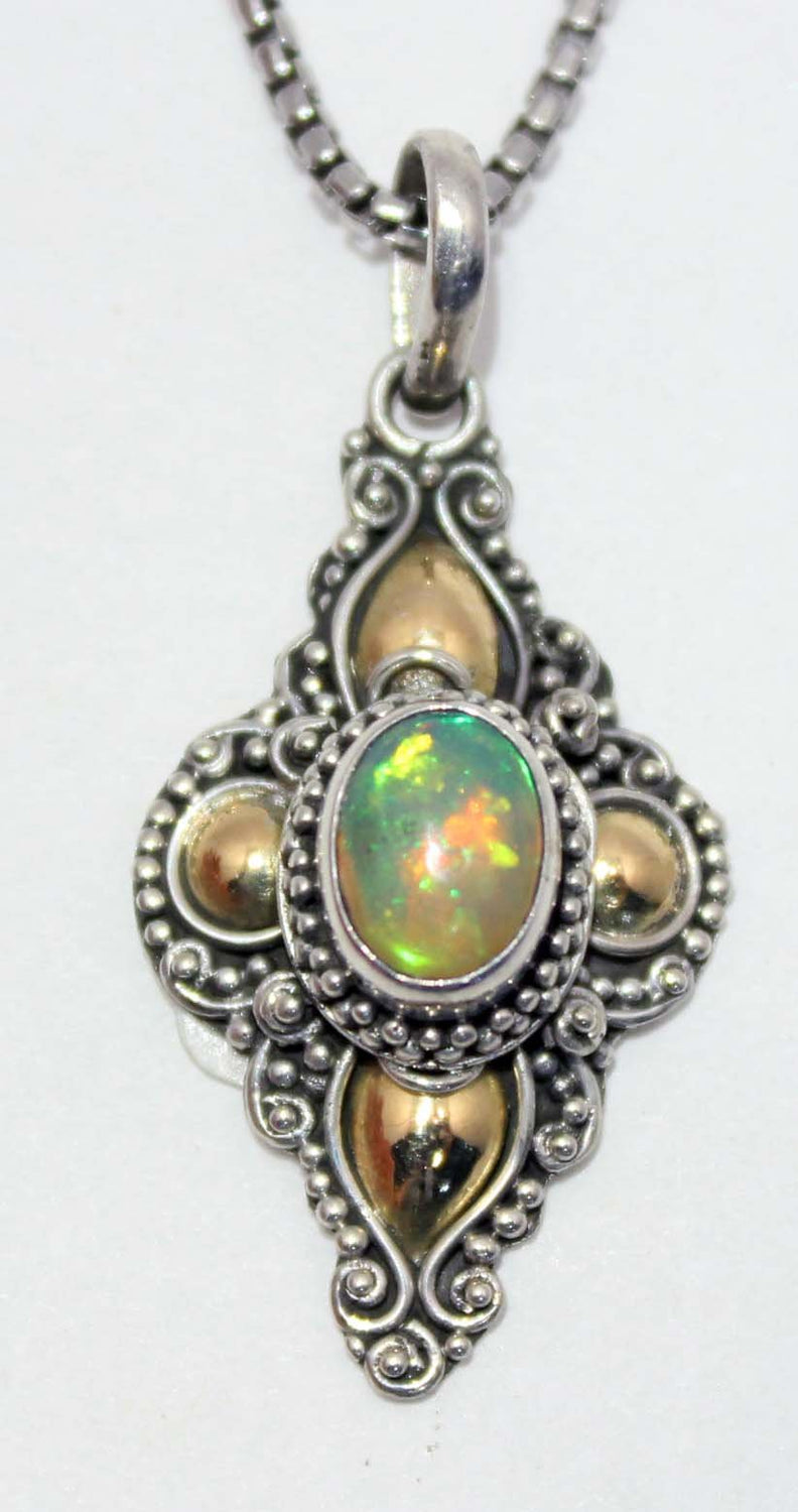 Gold silver ethiopian opal pendant midnight sun gold silver ethiopian opal pendant mozeypictures Choice Image
