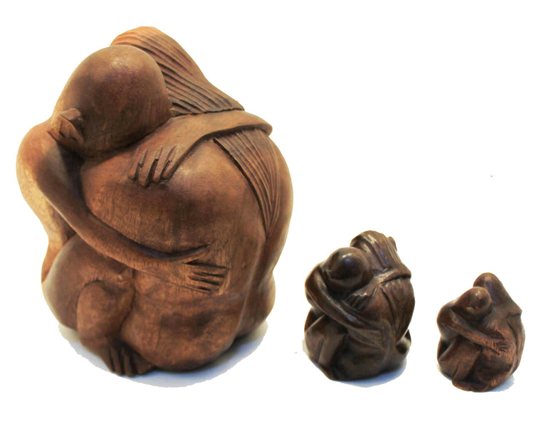 Hand Carved Hugging Couple