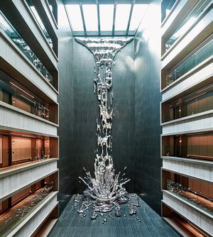 A Multi-Story Metallic Splash by Pere Gifre Drops Through the Center of a Madrid Hotel