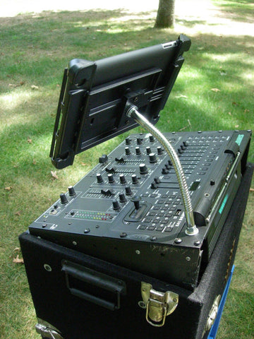 Heavy-Duty iPad & Tablet SnakeClamp holding an iPad at a DJ mixing board