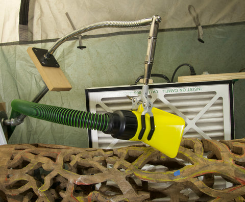 Versatile 3 Finger Clamp shown supporting a vacuum hose with a flexible gooseneck tube arm