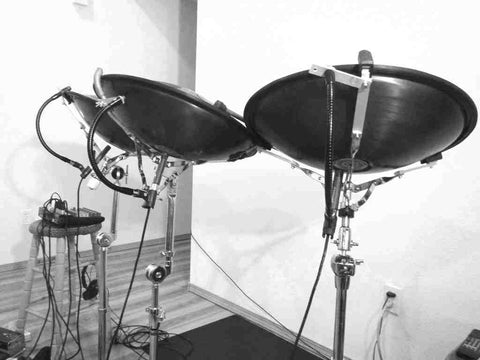 RAV Vast steel tongue drums mounted in modified snare drum stands.  SnakeClamp flexible gooseneck arms used to hold Sennheiser microphones under them for audio pickup.