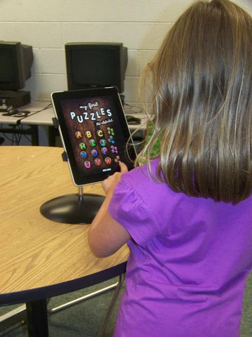 iPad SnakeClamp with flexible gooseneck arm holding an iPad in a elementary school classroom