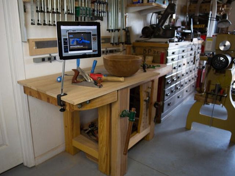 SnakeClamp shown holding an iPad in a workshop