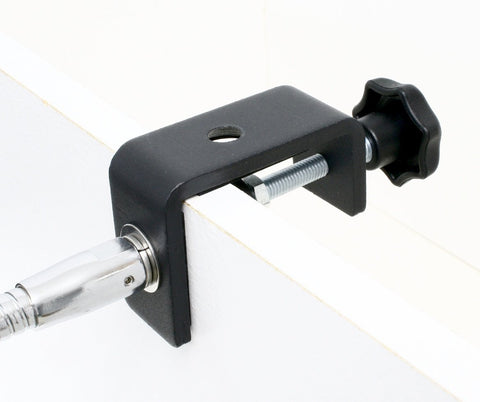 Table Clamp attached to vertical surface with flexible gooseneck arm attached horizontally.  It can also be attached vertically at the 2nd hole.