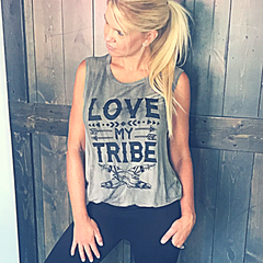 "We all know it takes a village to survive in this world, especially if you have kiddos. Show your ""tribe"" how much you love them in this tank!   This soft, loose fitting tank will be the perfect shirt to wear with jeans, short, or even our Black Active Leggings ($31.99).   Lolligag' in style on Lolligagin.com"