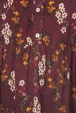 This plum floral print tunic top is a loose fit with a mandarin collar. The front tie, button trim, long sleeves and gathered details make it my new favorite top!   Pair it with shorts or jeans for a casual look, a pair of leggings for a comfortable feel, or even a pencil skirt for your next business meeting.  I promise...this will be your new favorite top too! Click on Lolligagin.com to purhcase!