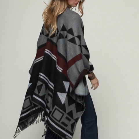 This wrap is for the days you are so cold but yet you want to look fashionable.  Grey/Burgundy Tribal yarn dyed woven Ruana / wrap with fringe accent.  Super soft feel with a trendy appearance. This is the perfect gift to give anyone on your list!