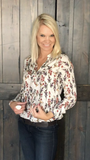 This ivory floral print tunic top is a loose fit with a mandarin collar. The front tie, button trim, long sleeves and gathered details make it my new favorite top!   Pair it with shorts or jeans for a casual look, a pair of leggings for a comfortable feel, or even a pencil skirt for your next business meeting.  I promise...this will be your new favorite top too! Click on Lolligagin.com to purhcase.