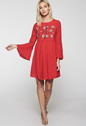 Red Floral embroidered long bell sleeve in a relaxed fit with open lace up back dress! Pair it with a pair of boots when it's cold, cute strappy heels for that special occasion or sandals for a fun summer day!
