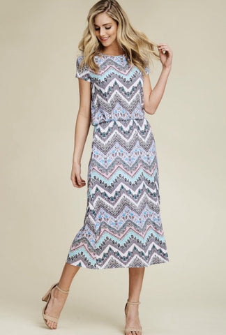 This soft knit bohemian zigzag print midi dress features a round neck, short sleeves,a flattering elastic waist, POCKETS and the perfect below the knee long length. Did I mention it has pockets??!!! Shop Lolligagin.com to purhcase.