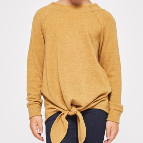 This sweater was one of our best sellers in black...introducing the same Boatneck Tie Sweater in Mustard! Long sleeves with self cuff, bottom tie detailing and beyond soft non-sheer knit fabric pairs perfectly with pants, shorts or skirts. Shop Lolligagin.com to purchase!