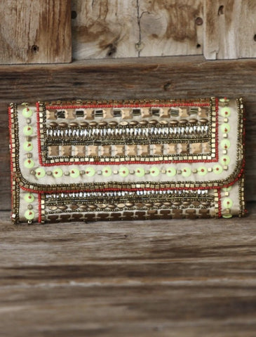 Enhance any outfit with this gorgeous Gold Beaded Clutch! Shop Lolligagin.com to purchase
