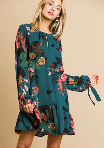 Floral Print Long Sleeve Keyhole Dress with Ruffle Hem and Sleeve Ties will be the perfect addition to your fall wardrobe.  Pair this adorable dress with some knee high boots or strappy heels and count the compliments! Shop Lolligagin.com to purchase.