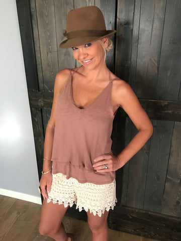 This 2-Tier Rust Tank with tie back is the perfect shirt to grab out of your closet for any occasion and any mood. Pair this flowy tank with jeans, shorts or leggings for multiple different looks.   For the Lolligagin' look, purchase the Ivory Lace Shorts ($29.99) and enjoy!!   Fits true to size!