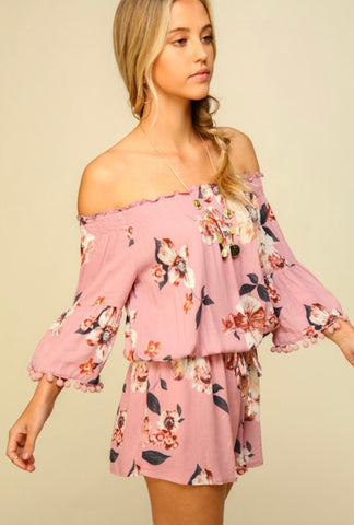 Too cute, right??!!   This floral off the shoulder 3-quarter pink sleeve romper is to DIE for!!  Do NOT let this one get away!    The flowing material is super soft, incredible quality and extremely comfortable!   True to size!
