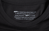 "007 x SPYSCAPE T-Shirt - Close up of inside neck with size tag, ""007 and related James Bond Trademarks, 1962-2019 Dan Janq, LLC and United Artist coorporation,  All rights reserved."