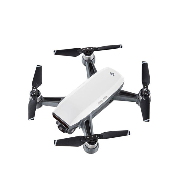 DJI Spark - Out of the box view of White DJI Spark drone with legs and fins opened