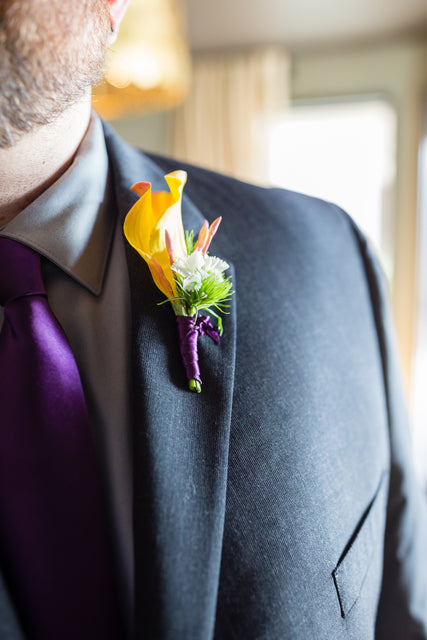 groom boutonniere with spring flowers