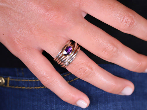Twisting Amethyst and Diamond Ring