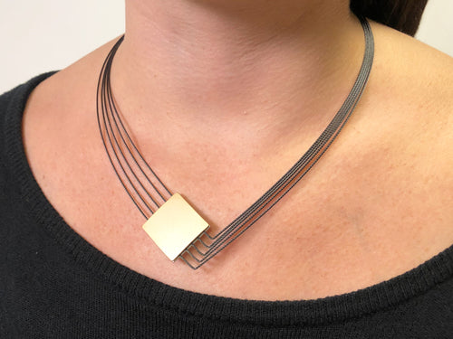 Gold- and Silver-Colored Pendant Necklace