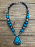 Tibetan Faux Turquoise Handmade necklace with a central pendant