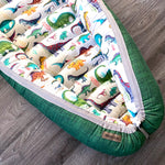 baby nest , baby lounging nest in dino bright fabric abd a green reverse side, co-sleeper, similar to dockatot and snuggle me products