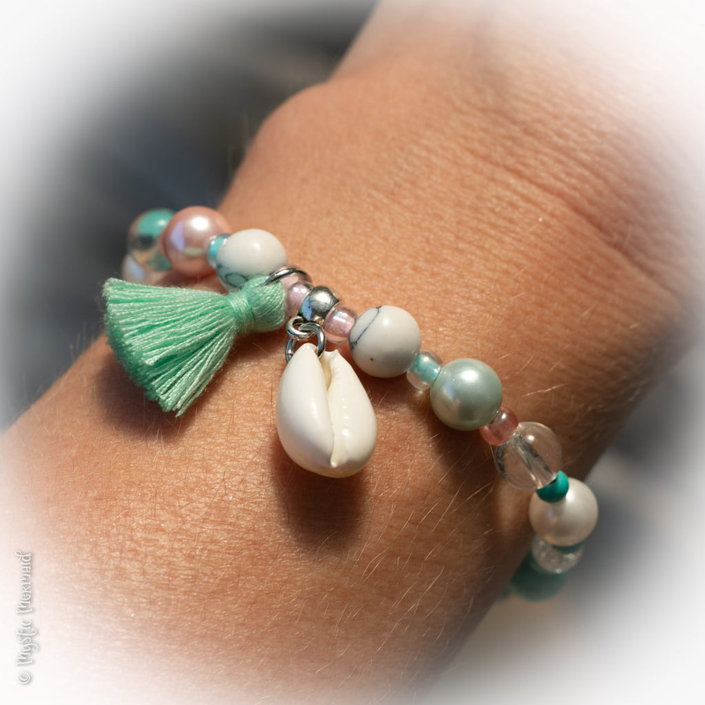 South Sea Pearl, Howlite and Clear Quartz stretch bracelet with cowrie shell and tassel