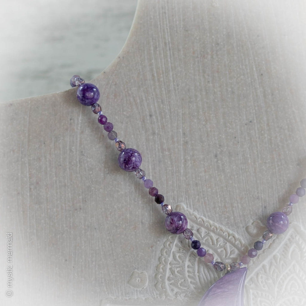 Stunning hand faceted sugilite interspersed between czech crystals and Divine Charoite