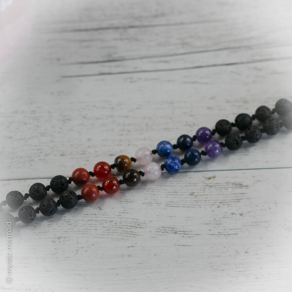 Chakra Mala featuring Black Lava Stone and Genuine Crystals with a Pure Silk Tassel