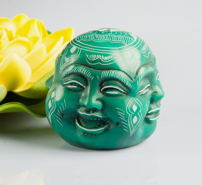 Four faces of buddha resin statue