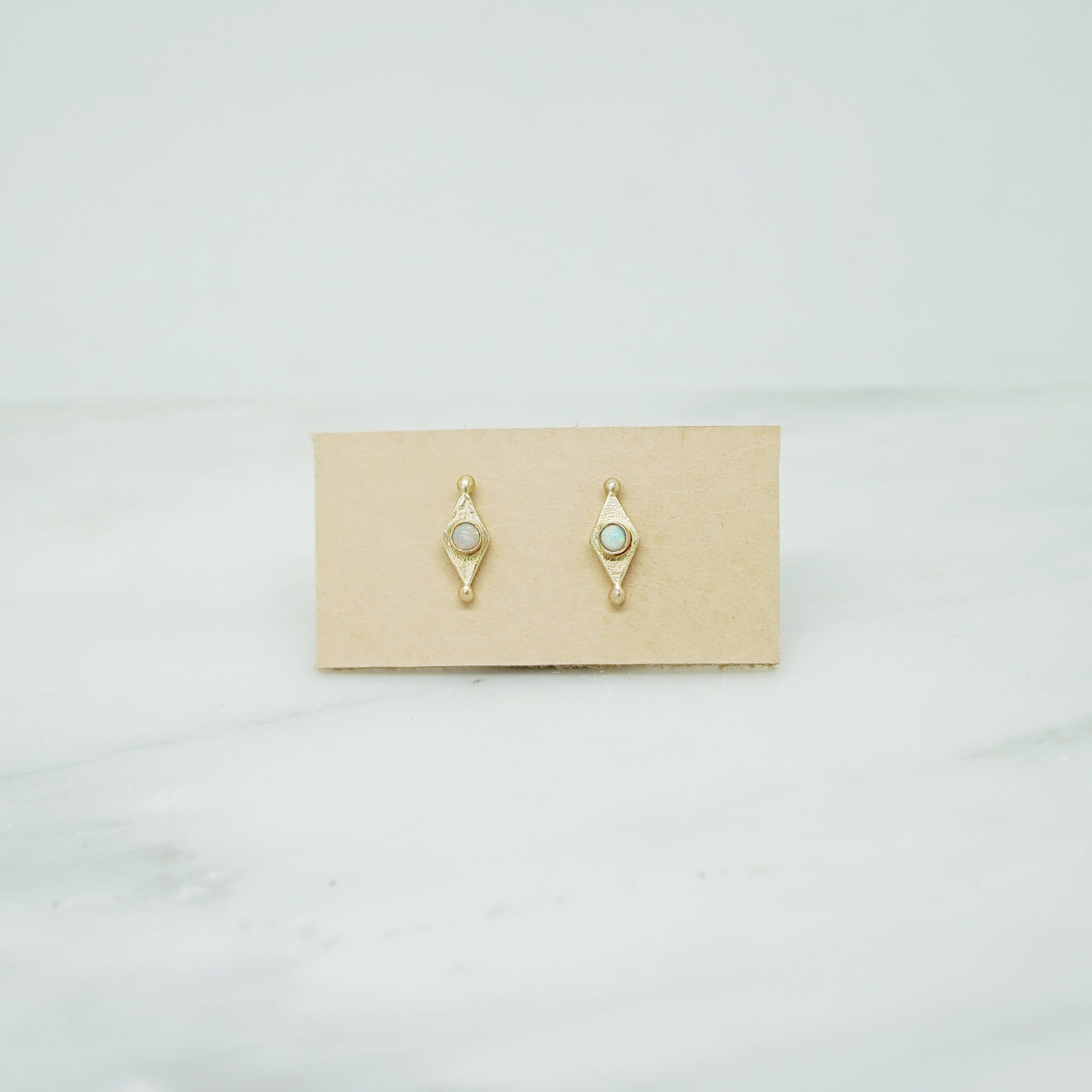Diamond shape studs with opal in 14K gold