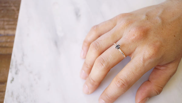 Solitaire ring with black raw diamond