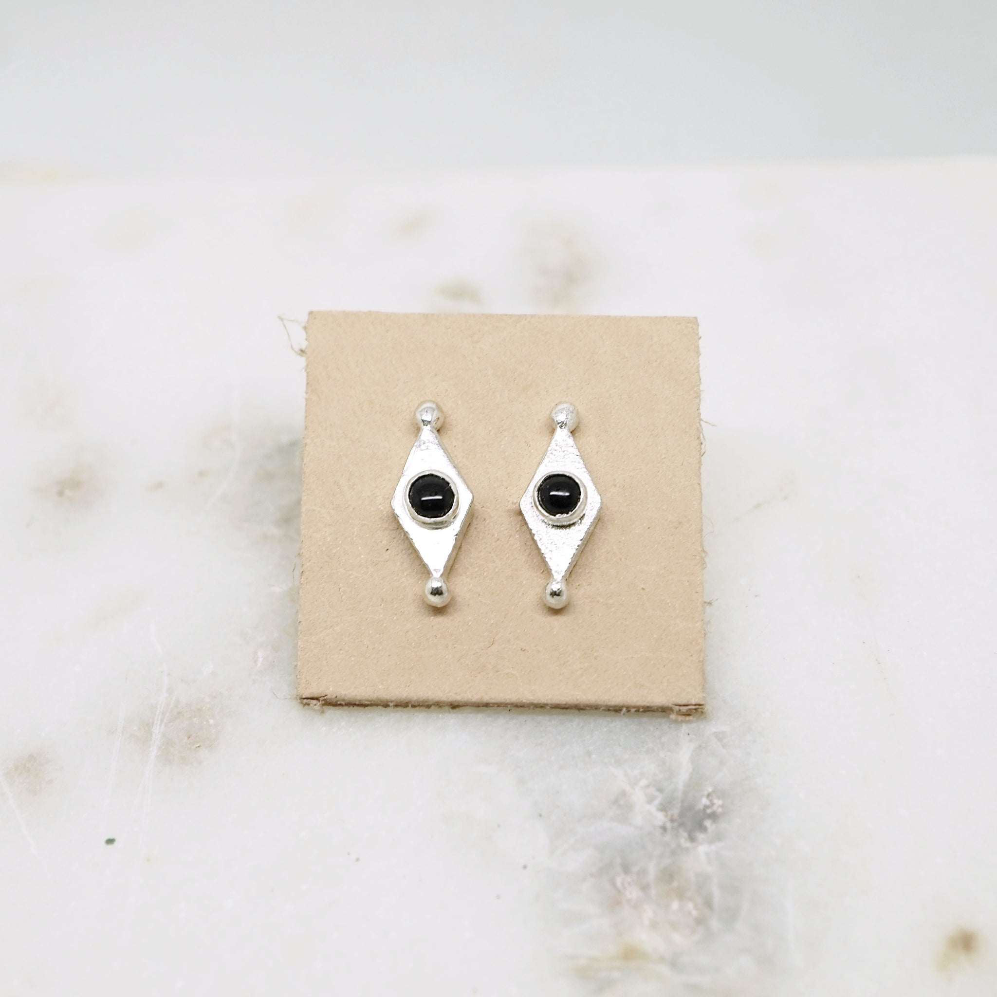 Diamond shape studs with Onyx