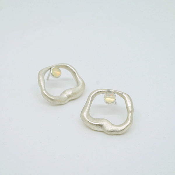 Abstract hole earrings with Opal