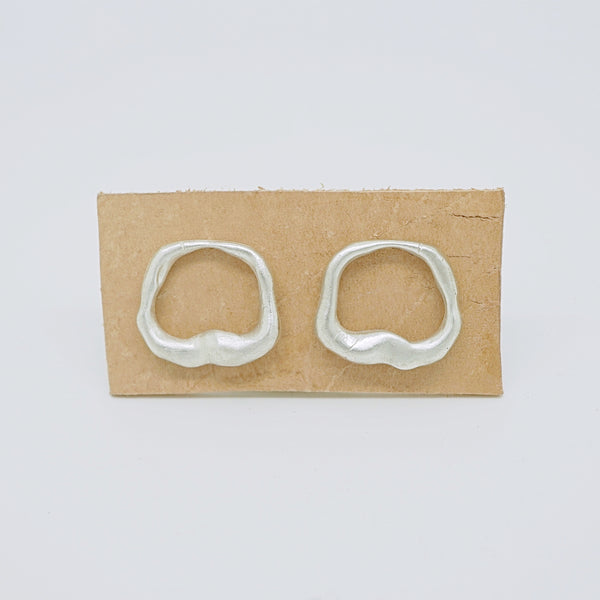 Abstract hole earrings