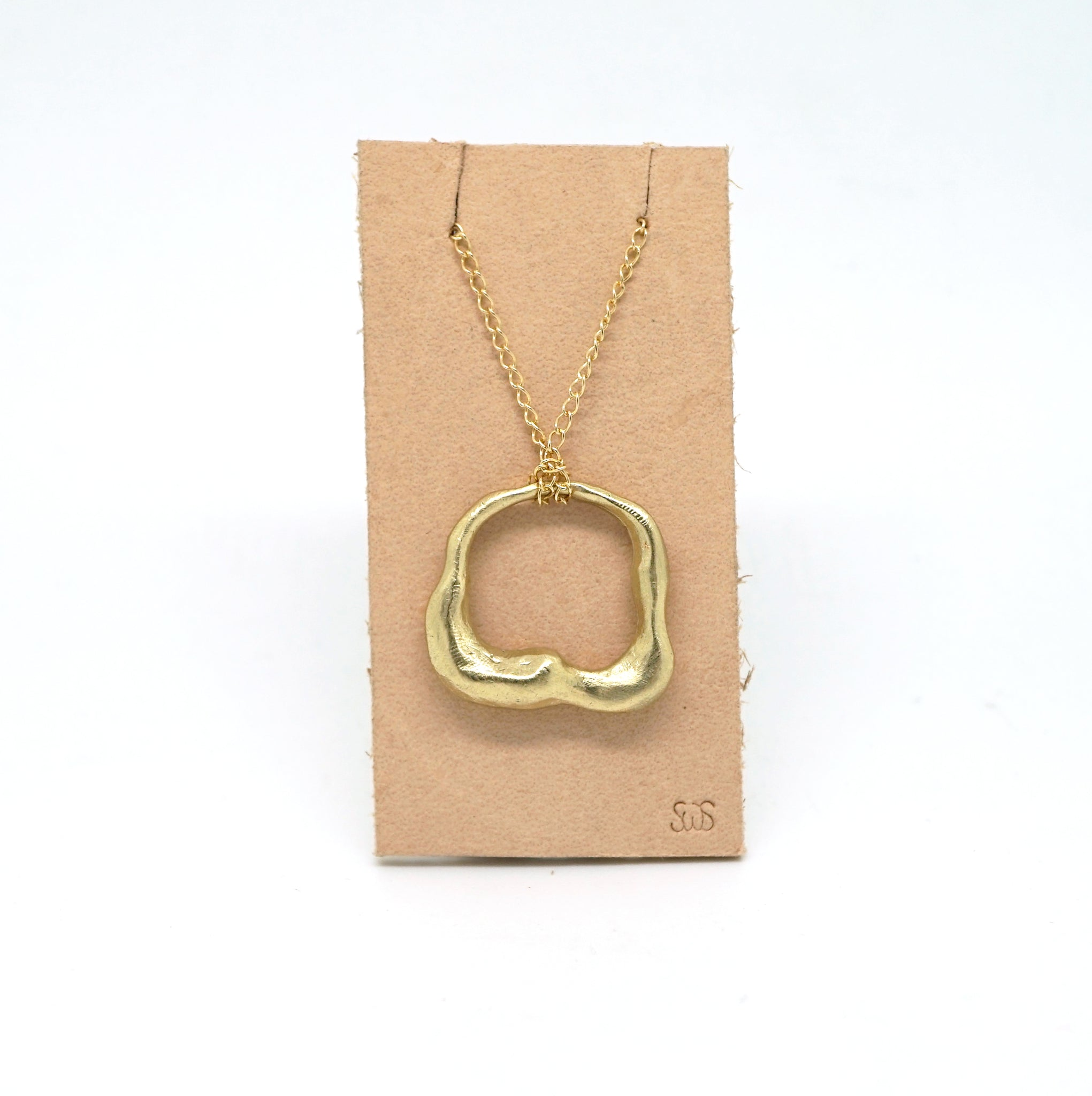 Abstract hole necklace in 14K gold