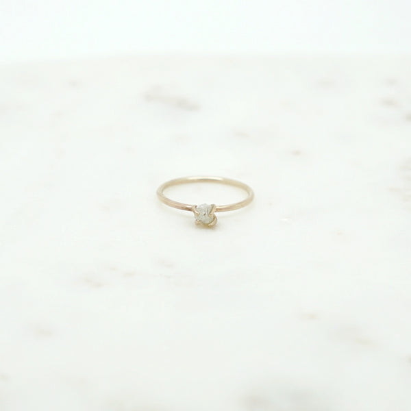 Solitaire ring with raw diamond in 14k gold