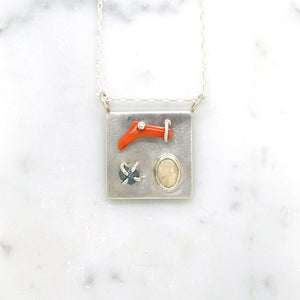 Art pendant necklace with coral, opal, and raw diamond