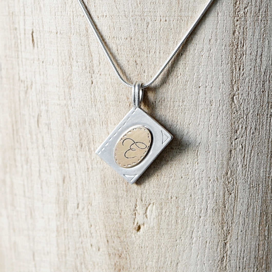 Initial book pendant necklace-14k gold & silver