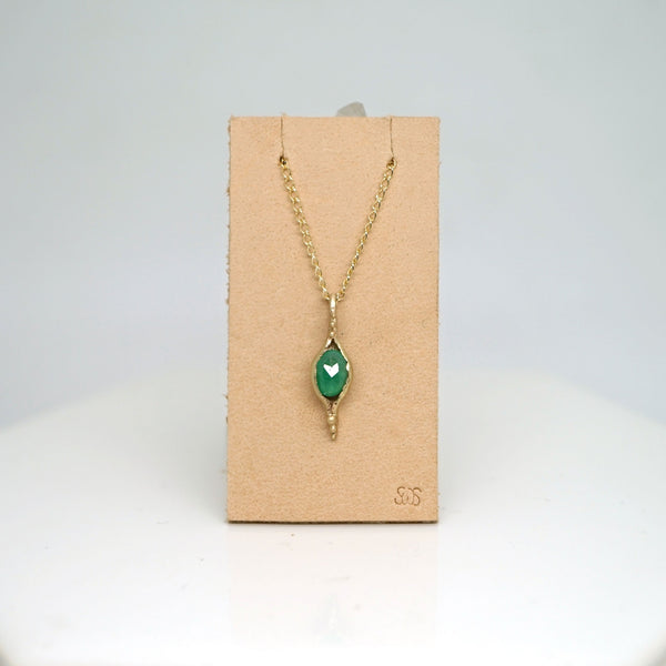 Pod pendant necklace with emerald